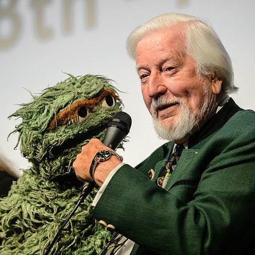Carroll Spinney holding Oscar the Grouch