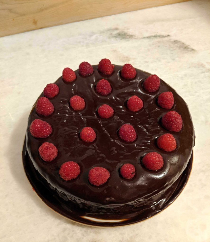 Chocolate cake with fresh raspberries on top